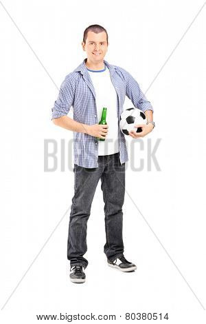 Full length portrait of a young football fan holding a beer isolated on white background