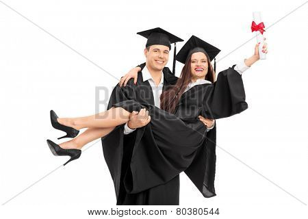 Young couple celebrating their graduation isolated on white background