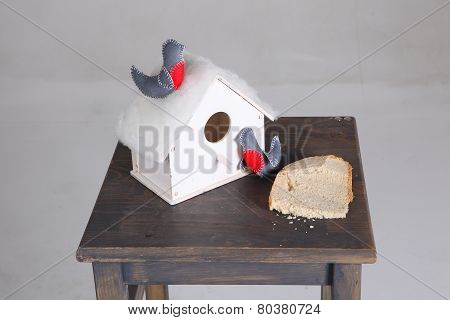 Decorative Small House For Birdies And A Bread Piece