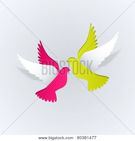Couple of paper doves on a white background