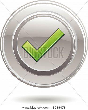Green tick in metal circle