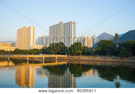 HONG KONG - OCT 18: Sha Tin district on evening on October 18, 2014 in Hong Kong, China. Shing Mun River and Sha Tin district located in the New Territories, Hong Kong