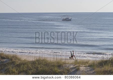 Ocean Runners And Fishing Trawler