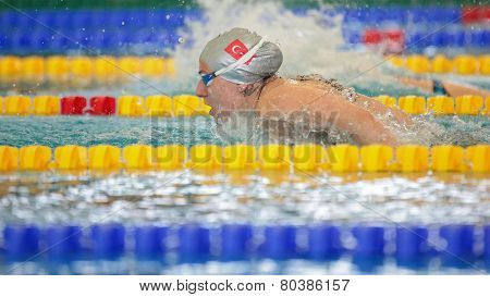 GRAZ, AUSTRIA - APRIL 05, 2014: Melisa Akarsu (Turkey) places 4th in the women's 200m butterfly event in an indoor swimming meeting.