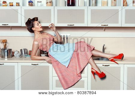 Woman Eating A Cake On The Table.