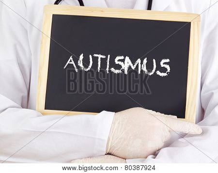 Doctor Shows Information On Blackboard: Autism In German
