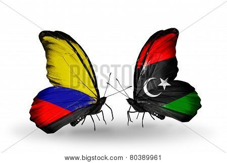 Two Butterflies With Flags On Wings As Symbol Of Relations Columbia And Libya