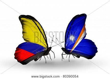 Two Butterflies With Flags On Wings As Symbol Of Relations Columbia And Marshall Islands