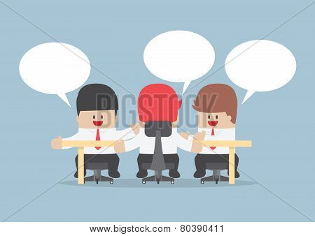 Group Of Businessmen Brainstorming Together At Conference Table