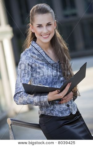 Happy Businesswoman With Document Folder