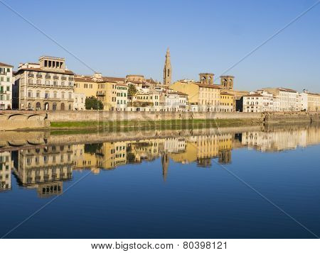Italy, buildings of Florence reflected in Arno river