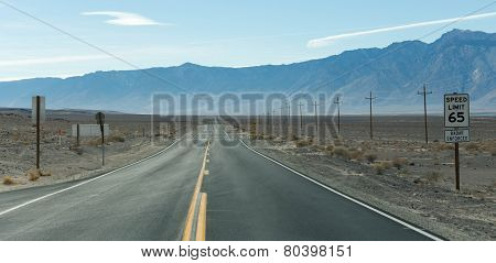 Straight road in desert