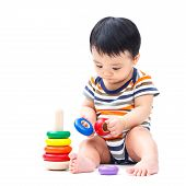 foto of non-toxic  - Cute asian baby playing toy isolated on white - JPG