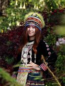 stock photo of hmong  - Traditionally dressed Mhong hill tribe woman in the garden at mountain - JPG