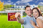 pic of key  - Mixed Race Excited Military Couple In Front of New Home with New House Keys and Sold Real Estate Sign Outside - JPG
