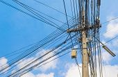 pic of utility pole  - image of busy line on electric pole  - JPG