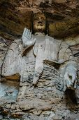 stock photo of enormous  - An enormous Bodhisattva sitting in a huge cave in Yungang Grotto in China - JPG