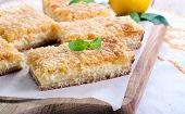 foto of cheesecake  - Lemon and cheesecake bars on chopping board - JPG