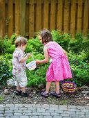 ������, ������: Little Boy And Girl Searching For Easter Eggs