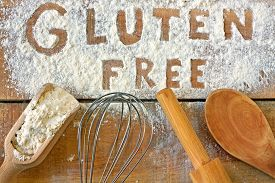 stock photo of pegging  - a gluten free word with wood background - JPG