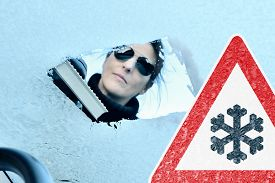 picture of scrape  - Woman scraping ice from a windshield  - JPG
