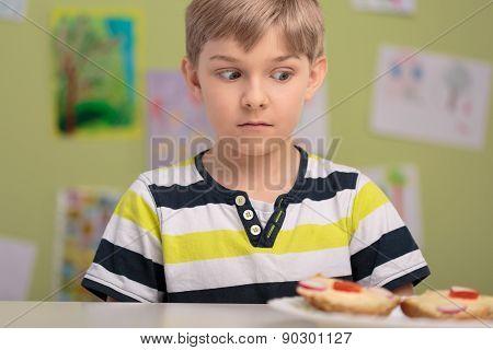 Schoolboy With Breakfast At School