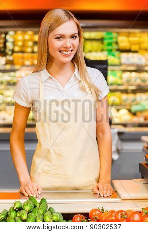 Young woman worker in grocery store