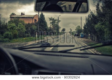 Urban Driving  On A Rainy Day