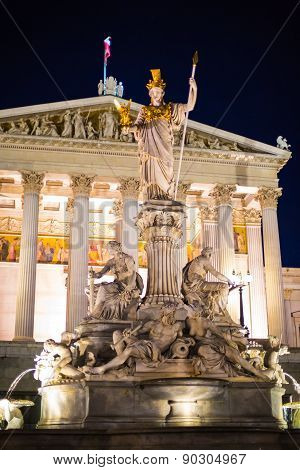 Night View Of Parliament Building In Vienna, Austria And Pallas Athena Brunnen Statue