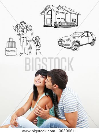 Dreaming concept. Loving couple sitting on floor in room
