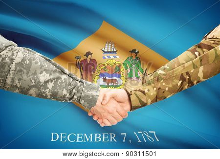 Military Handshake And Us State Flag - Delaware