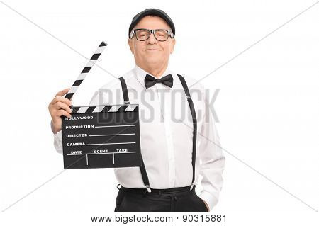 Confident mature movie director holding a clapperboard and looking at the camera isolated on white background