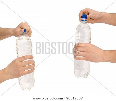 Hand To Open A Bottle With Water