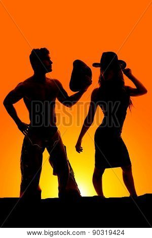 Silhouette Of A Cowgirl Hat On Showing Body Shape With Cowboy