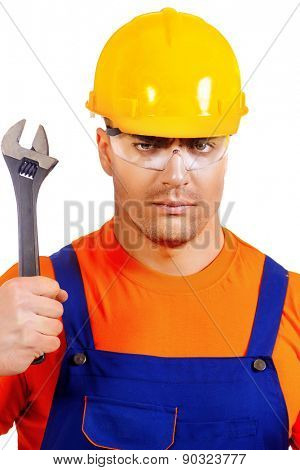 Close-up portrait of a handsome construction worker. Job, occupation. Isolated over white.