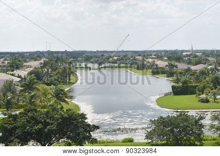 A view of Community Lake in Davie, Florida on the hill with blue sky and white clouds in the back gr