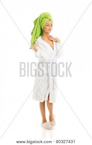 Full length woman posing in bathrobe.