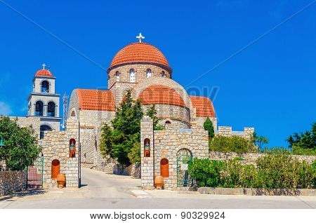 Greek monastery with classic red roofing, Greece