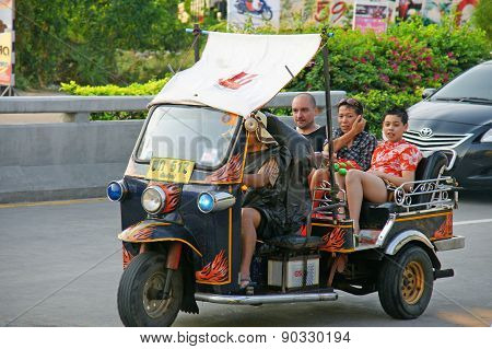 Unidentified Tourist With Traditional Tuk-tuk In Thailand.