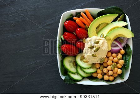 Healthy nourishment bowl with super-foods and fresh vegetables