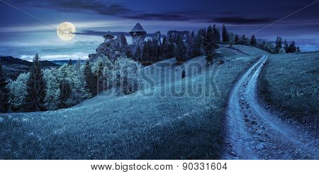 Path To Fortress Ruins On Hillside With Forest At Night