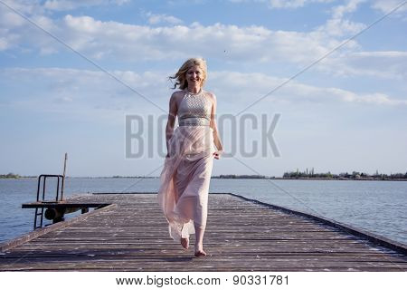 Blond Woman In Evening Gown Running