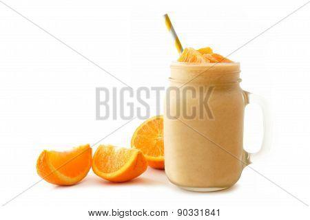 Isolated orange smoothie in mason jar with fruit slices