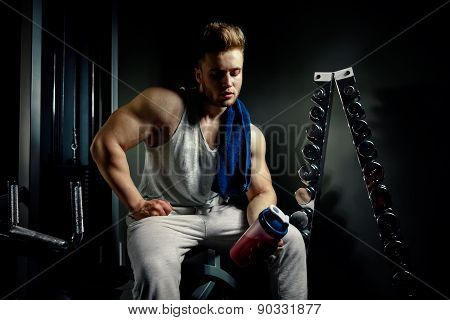 Strong Bodybuilder Athlete With Protein Shaker And Towel