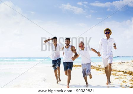 Group of male friends on holidays at the beach