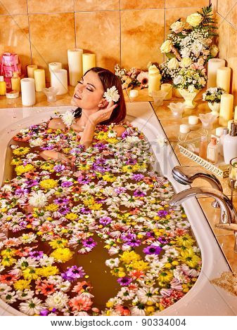 Woman relaxing at water spa. Aromatherapy.