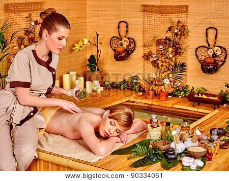 Woman getting relax massage in  spa resort. Pool with water.