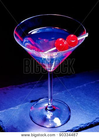 Transparent two cherry cocktail on black background. Top view. Cocktail card 37.