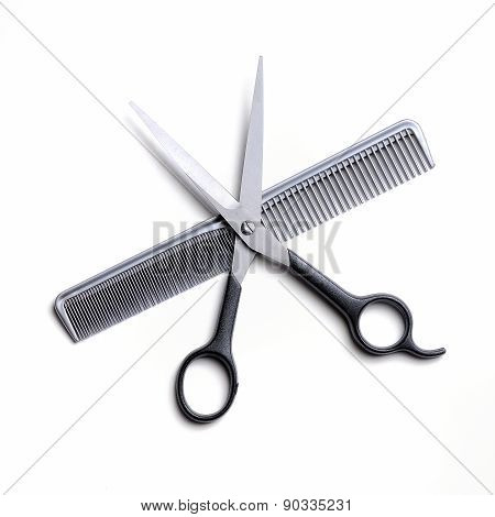 Open Scissors On A Gray Comb Isolated