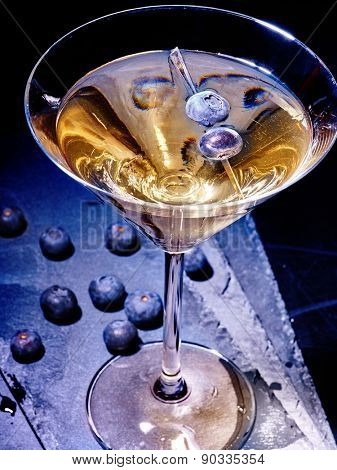 Blueberry gold drink on black background. Cocktail card